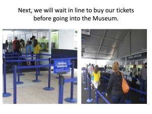 Stanchions arranged in front of the ticket kiosks with people waiting in line