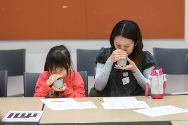 adult and child smell tea