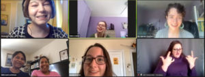 7 people in 6 Zoom windows smile at each other.